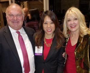 Leech Tishman Partner Alan Kindred (left), his spouse Lorraine (right) stand with CA State Treasurer Fiona Ma (Center)
