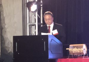 Leech Tishman Partner & HKASC President, Danton Mak, presents before a podium
